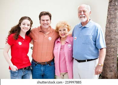 Family wearing their I Voted stickers on election day.  (stickers are generic, not trademarked)
