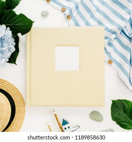 Family wedding photo album, hydrangea flower bouquet, striped blanket, straw hat on white background. Flat lay, top view blog her header.
