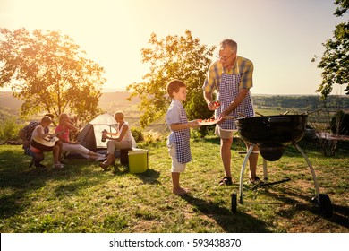 family weekend with barbecue in park