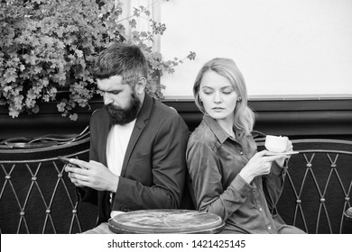 Family weekend. Married lovely couple relaxing together. Couple cafe terrace drink coffee. Couple in love sit cafe terrace enjoy coffee. Man secret messaging cheating on wife. Cheat and betrayal.