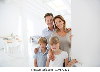 Family welcoming people at entrance door