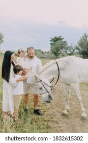 Family in white clothes in a field