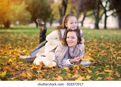 Family woman and daughter walk autumn park