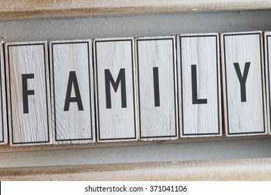 FAMILY word written on wooden