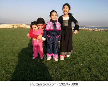 A family of young men and three girls in the air and the beautiful nature of Jubail in the Kingdom of Saudi Arabia in the summer of 2018