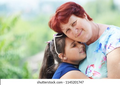 Family,smiling granny with granddaughter,love,photo