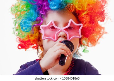 The famous actress. Humorous photocute child girl singing with a microphone (Happy childhood, teaching singing, music, child development concept)