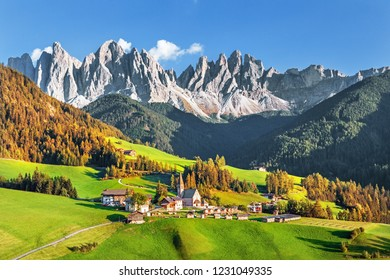 Famous alpine place  Santa Maddalena village with magical Dolomites mountains in background, Val di Funes valley, Trentino Alto Adige region, Italy, Europe
