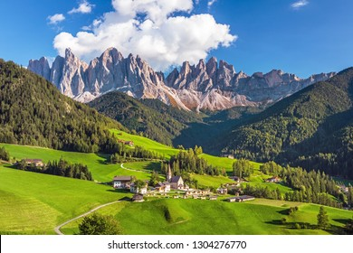 Famous alpine place of the world, Santa Maddalena village with magical Dolomites mountains in background, Val di Funes valley, Trentino Alto Adige region, Italy, Europe