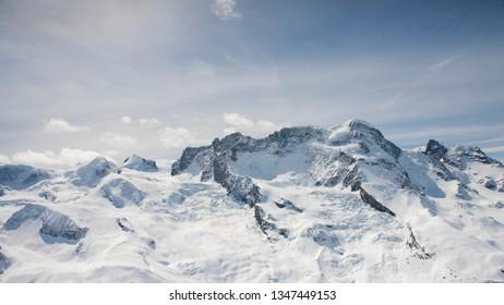 The famous alps mountain peak with cloudy and blue sky from Gornergrat, Zermatt, Switzerland