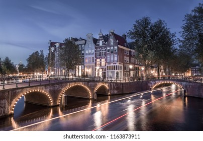 Famous Amsterdam Canal Scene with Light trails. After Sunset