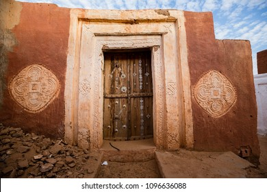 Famous ancient arabic door paintings at medieval bricked house in World Heritage Site Walata, Mauritania