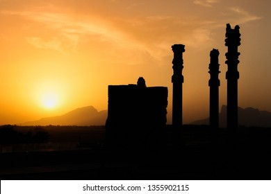 The famous ancient city of Persepolis in Iran (Persia) at sunset. Silhouettes of columns at sunset