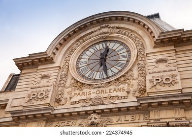 Famous ancient clock on the wall of Orsay Museum in Paris