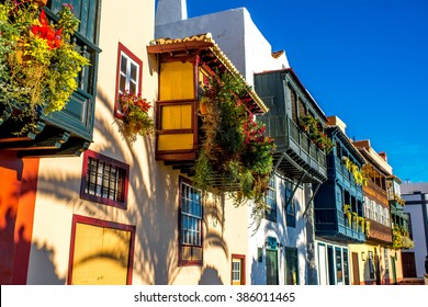 Famous ancient colorful balconies decorated with flowers in Santa Cruz city on La Palma island in Spain