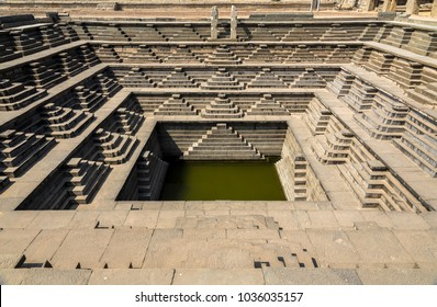 The famous ancient Stepped Tank in Hampi, excavated from ruins of 14th century Vijayanagara kingdom.
