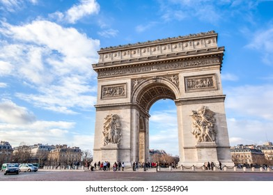 Famous Arc de Triomphe against nice blue sky  Arc de Triomphe monument at at the western end of the Champs-elysees road in Paris, France