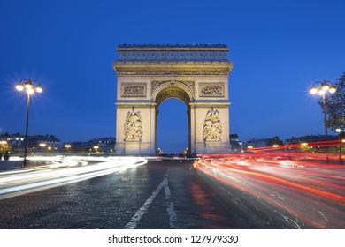 The famous Arc de Triomphe by night, Paris France