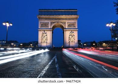 famous Arc de Triomphe by night, Paris France