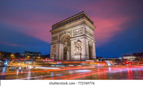 Famous Arc de Triomphe at twilight in Paris, France