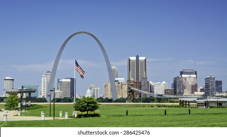Famous arch in St. Louis and flag