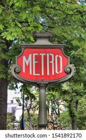 Famous Art Nouveau sign for the Metropolitain subway in Paris, France