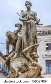 Famous Artemis (Diana) Fountain on Archimedes Square on the Ortygia isle - old town of Syracuse on Sicily island, Italy