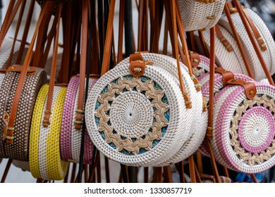 Famous Balinese rattan eco bags in a local souvenir market on street in Ubud, Bali, Indonesia. Handicrafts and souvenir shop display, close up