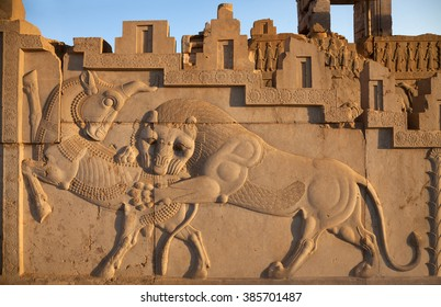 Famous bas relief carving of a lion hunting a bull in Persepolis World Heritage Site, which used to decorate the wall of kingdom palace in Achaemenid Empire, 500 BC.