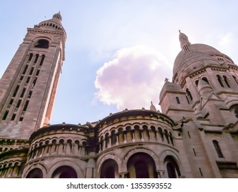The famous Basilica of the Sacred Heart of Paris or Sacré-Cœur Basilica located in Montmartre district in Paris, France. Montmartre is also known as La Butte is a charming hilltop neighborhood.