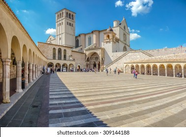 Famous Basilica of St. Francis of Assisi (Basilica Papale di San Francesco) with Lower Plaza in Assisi, Umbria, Italy
