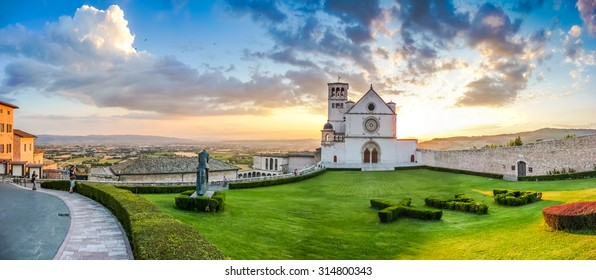 Famous Basilica of St. Francis of Assisi (Basilica Papale di San Francesco) at sunset in Assisi, Umbria, Italy