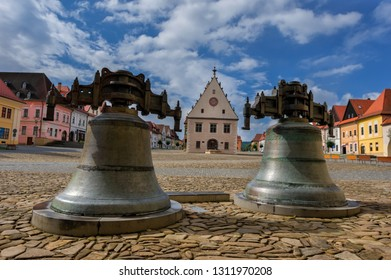 Famous baths Bardejov in Slovakia with old historical town square with pair of big iron bells surrounded by preserved bourgeois houses with colorful facades listed in UNESCO world heritage