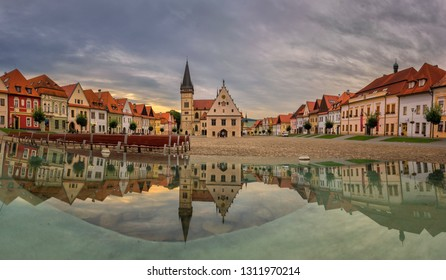 Famous baths Bardejov in Slovakia with old historical town square with preserved bourgeois houses with colorful facades listed in UNESCO world heritage with mirror reflection on water
