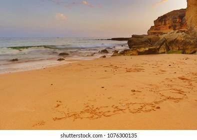 the famous beach of Olhos de Agua in Albufeira. Long exposure, Algarve, Portugal.