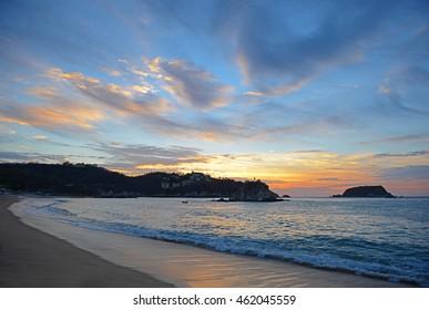 The famous beach of Tangolunda at sunrise, Huatulco, Mexico.