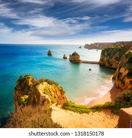 Famous beaches, cliffs and the sea in Lagos, Portugal attract many tourists and vacationers in the summer, and almost deserted in the winter, even though it is warm there