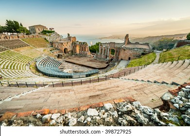 The famous and beautiful ancient greek theatre ruins Taormina in sunset, Messina, Sicily, Italy