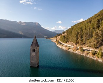The famous bell tower in the Lake of Reschen (Reschen See - Lago di Resia) in Südtirol, Italy. During WW2 a dam was build and put the village under water, only the tower is still visible now.
