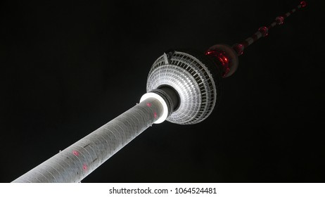 Famous Berlin TV tower landmark Fernsehturm detail building in diagonal low angle night view