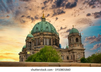 The famous Berliner Dom (Berlin Cathedral) in Berlin at sunset, view from the Friedrichsbrücke - Shutterstock ID 1910801860
