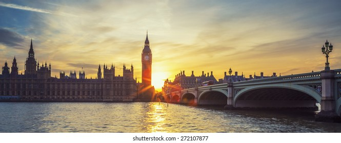 Famous Big Ben clock tower in London at sunset, panoramic view, UK.