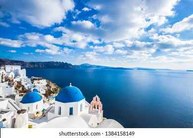 Famous blue domes of churches in Oia city on Santorini island, Greece