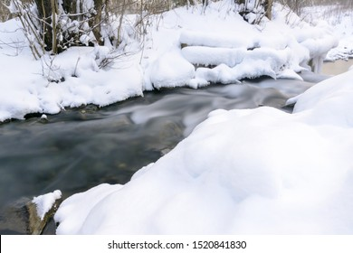 Famous blue lakes of karst origin. Blue lakes do not freeze in winter and feed on groundwater. Winter rapids and stream. Lakes Russia, Kazan. Winter landscape.
