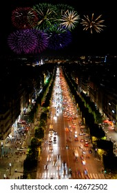 Famous boulevard Champs Elysees in Paris, France and celeberation fireworks