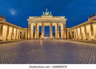 The famous Brandenburg Gate in Berlin illuminated at dawn