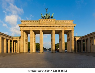 Famous Brandenburger Tor (Brandenburg Gate), one of the best-known landmarks and national symbols of Germany, in beautiful golden morning light at sunrise, Berlin, Germany