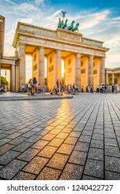 Famous Brandenburger Tor, one of the best-known landmarks and national symbols of Germany, in beautiful golden evening light at sunset, Berlin, Germany