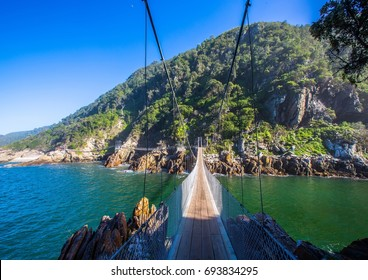 Famous bridge over Storms River Mouth at the Indian Ocean in South Africa