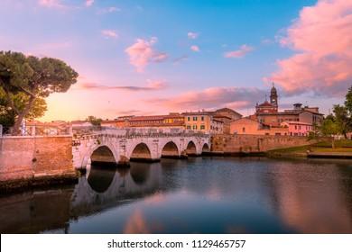 Famous bridge in Rimini, Italy. Rimini landmarks. Beautiful Rimini cityscape in the evening.